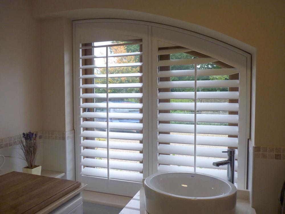 bespoke shaped wooden window shutters london